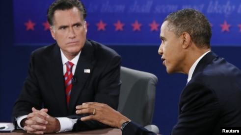 U.S. President Barack Obama speaks as Republican presidential nominee Mitt Romney listens during the final U.S. presidential debate in Boca Raton, Florida, October 22, 2012.