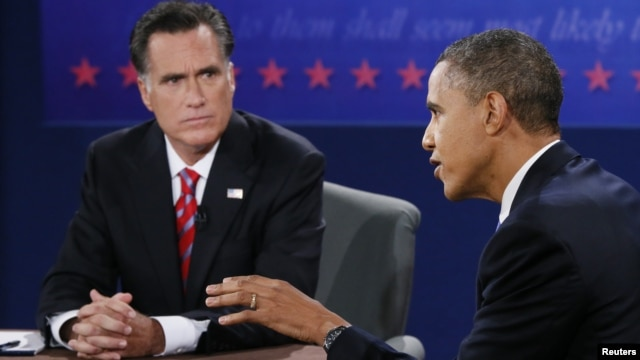U.S. President Barack Obama speaks as Republican presidential nominee Mitt Romney listens during the final U.S. presidential debate in Boca Raton, Florida, October 22, 2012.