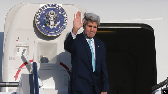 U.S. Secretary of State John Kerry waves to bid farewell in Sydney, Australia, Wednesday, Aug. 13, 2014.