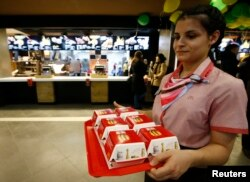 A McDonald's employee holds a tray of Big Mac burgers at the company's restaurant in central Moscow, Jan. 31, 2017.