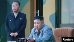 Kim Jong Un watches the test-fire of two short-range ballistic missiles