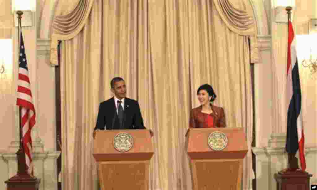 U.S. President Barack Obama, left, speaks as Thai Prime Minister Yingluck Shinawatra listens during a joint press conference at the Government House in Bangkok, Thailand, Sunday, Nov. 18, 2012. (AP Photo/Sakchai Lalit)