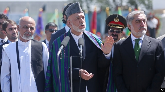 Afghan President Hamid Karzai speaks during the Independence Day ceremony in Kabul, Afghanistan, Aug. 19, 2014.