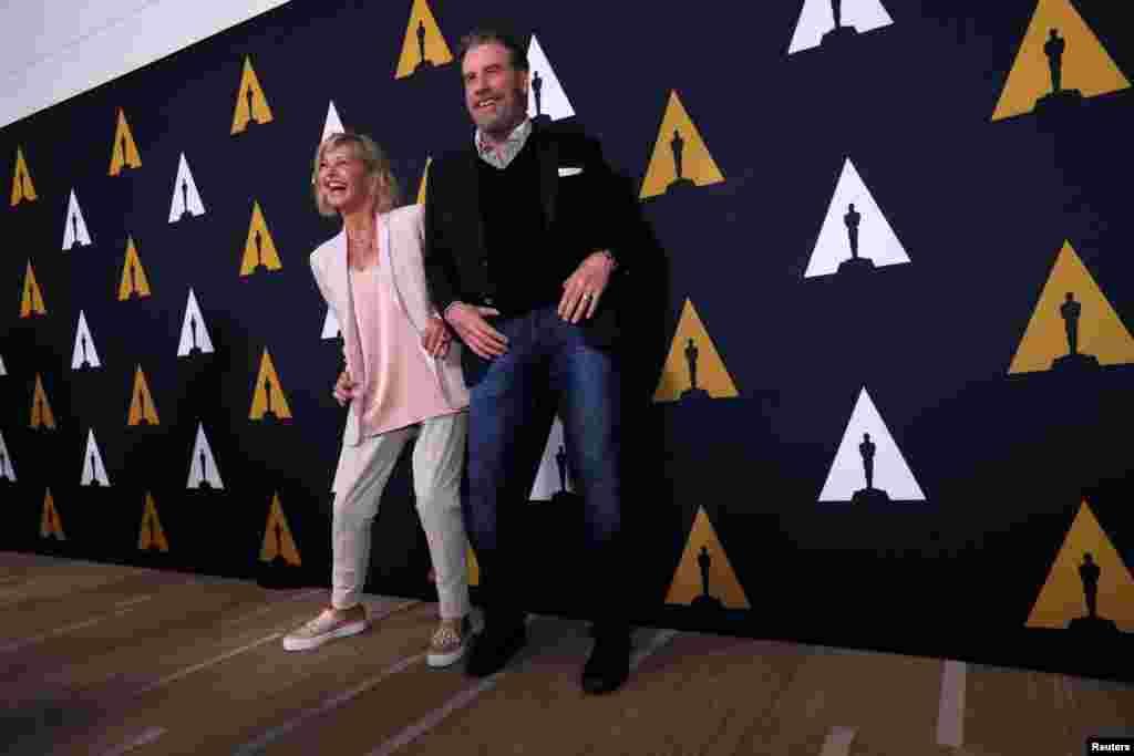"""Kaliforniya - Beverli Hills, Con Travolta və Oliviya Nyuton Con """"Grease"""" filminin ekrana çıxmasının 40-cı ildönümü mərasimində"""