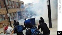 警方发射催泪弹驱散20国集团峰会抗议者