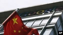 A Chinese national flag waves in front of the former headquarters of Google China in Beijing June 2, 2011. Suspected Chinese hackers tried to steal the passwords of hundreds of Google email account holders, including those of senior U.S. government offici