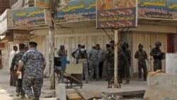 Iraqi security forces inspect the scene of a robbery in New Baghdad, Iraq, Thursday, Aug. 5, 2010. Gunmen stormed a Baghdad money exchange and killed three people, the latest in recent brash daylight attacks on banks, financial and trade centers in the Ir