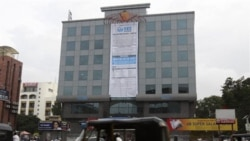 A banner announces the public stock sale of SKS Microfinance at the company's headquarters in Hyderabad in July