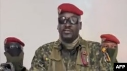 A screengrab taken from footage sent to AFP by a military source shows Guinean Colonel Mamady Doumbouya delivering a speech following the dissolution of the government during a coup d'etat in Conakry, September 5, 2021.