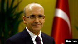 FILE - Turkish Deputy Prime Minister Mehmet Simsek is in Ankara, Dec. 23, 2015.