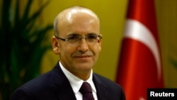 FILE - Turkish Deputy Prime Minister Mehmet Simsek is in Ankara, Dec. 23, 2015.