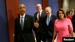 (L-R) U.S. President Barack Obama arrives with New York Rep. Joe Crowley, Senate Democratic Leader Chuck Schumer and House Democratic Leader Nancy Pelosi to meet with House and Senate Democrats to discuss strategy