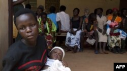 Women queue with their babies to be tested for HIV at a hospital in Bududa, eastern Uganda, September 27, 2011.