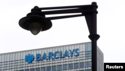 FILE - A security camera is seen near a Barclay bank office at Canary Wharf in London, Britain, May 19, 2015.