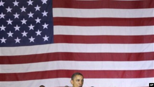 President Barack Obama speaks to troops at a rally during an unannounced visit at Bagram Air Field in Afghanistan, Dec. 3, 2010