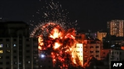 An explosion is pictured among buildings during an Israeli airstike on Gaza City on May 4, 2019.