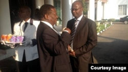 New Justice Minister Emmerson Mnangagwa and Information Minister Jonathan Moyo