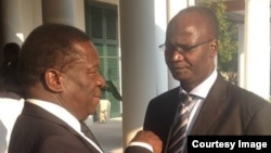 Higher Education Minister Professor Jonathan Moyo and Vice President Emmerson Mnangagwa.