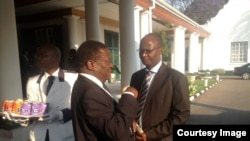 FILE: Vice President and Justice Minister Emmerson Mnangagwa and Higher Education Minister Jonathan Moyo.