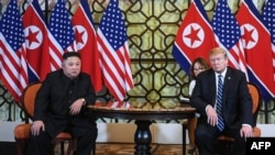 FILE - U.S. President Donald Trump and North Korea's leader Kim Jong Un meet during the second U.S.-North Korea summit at the Sofitel Legend Metropole hotel in Hanoi, Feb. 28, 2019.