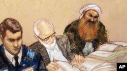 FILE - A sketch by a courtroom artist shows alleged 9/11 mastermind Khalid Sheikh Mohammed, right, during a pretrial hearing at the Guantanamo Bay Naval Base in Cuba, Feb. 12, 2013.