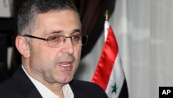 FILE - Ali Haidar, the Syrian Minister for Reconciliation Affairs, is interviewed in Damascus, Syria.