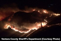 An aerial photo taken by the Ventura County Sheriff's Department shows the brush fire that broke out late Friday near U.S. Highway 101 south of Carpinteria, Calif.
