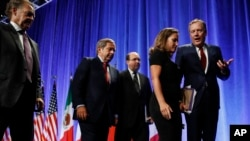 Canadian Chief Negotiator Steve Verheul, left, walks next to Canadian Ambassador to the U.S. David McNaughton, and U.S. Chief Negotiator John Melle, as Canadian Foreign Affairs Minister Chrystia Freeland, talks with U.S. Trade Representative Robert Lighthizer, right, after a news conference, Aug. 16, 2017, at the start of NAFTA renegotiations in Washington.