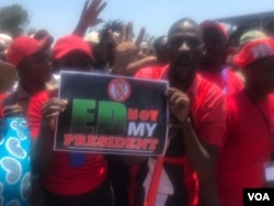 Members of the MDC led by Nelson Chamisa carrying a placard inscribed 'ED Not My President'