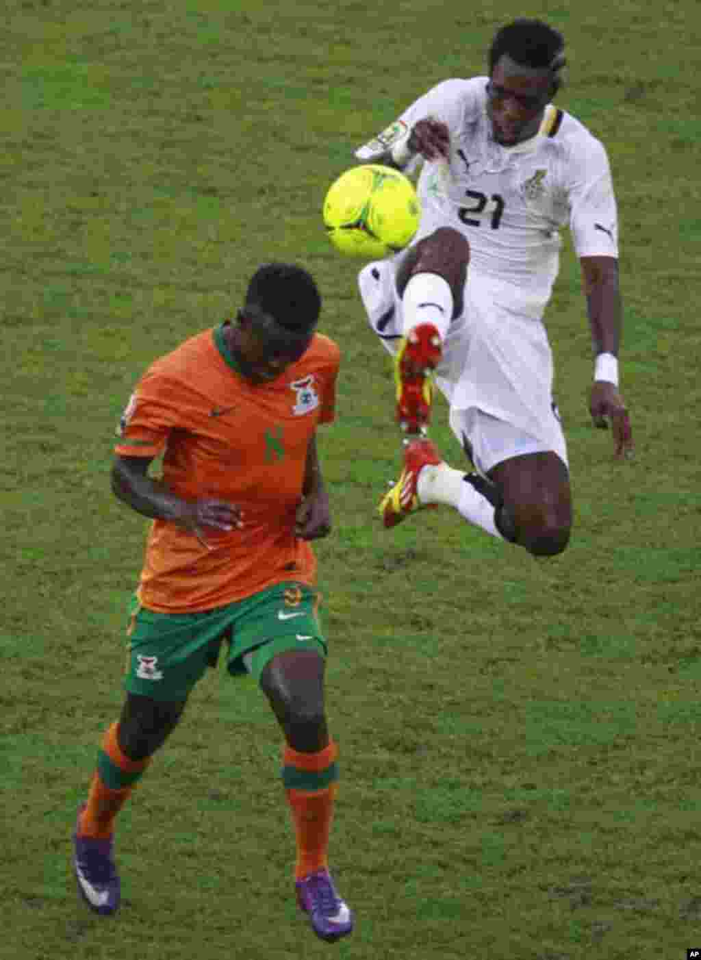 "Isaac Chansa (bottom) of Zambia fights for the ball with John Boye of Ghana during their African Nations Cup semi-final soccer match at Estadio de Bata ""Bata Stadium"" in Bata February 8, 2012."