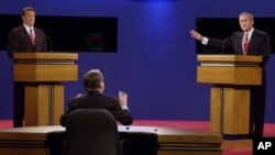 Moderator Jim Lehrer tells Republican presidential candidate Texas Gov. George W. Bush, right, that the candidates made the rules as Democratic presidential candidate Vice President Al Gore listens at the first presidential debate Tuesday, Oct. 3, 2000, a