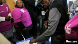 Archbishop Emeritus Desmond Tutu casts his vote during local government elections in Milnerton, Cape Town, South Africa, Aug. 3, 2016.