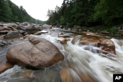 FILE - The Wassataquoik Stream flows through Township 3, Range 8, Maine, on land owned by environmentalist Roxanne Quimby, the co-founder of Burt's Bees. President Barack Obama in 2016 created the Katahdin Woods and Waters National Monument on 87,000 acres donated by Quimby.