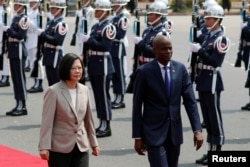 Taiwan's President Tsai Ing-wen and Haiti's President Jovenel Moise review the honor guard at a welcoming ceremony, in Taipei, Taiwan, May 29, 2017.