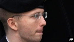 FILE - Army Pfc. Chelsea Manning, then-Army Pfc. Bradley Manning, is escorted into a courthouse in Fort Meade, Maryland, Aug. 21, 2013, before a sentencing hearing in his court martial.