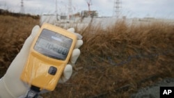 A radiation monitor indicates 102.00 microsieverts per hour at Tokyo Electric Power Co. (TEPCO)'s tsunami-crippled Fukushima Dai-ichi nuclear power plant in Fukushima prefecture, northeastern Japan, Feb. 20, 2012.