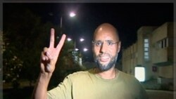 Saif Al-Islam, son of Libyan leader Muammar Gaddafi, gestures in Tripoli August 23, 2011 in this still image taken from video. Saif told journalists that Libya, which has been largely overrun in the past 24 hours by rebel forces seeking to topple his fath