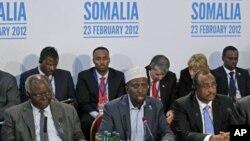 The President of Somalia, Sheikh Sharif Ahmed (C) speaks, as the President of Kenya, Mwai Kibaki (L) and Prime Minister of Somalia TFG, Abdiweli Mohamed Ali, listen during the London Conference on Somalia, in London, February 23, 2012.
