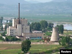FILE - A North Korean nuclear plant is seen before demolishing a cooling tower (R) in Yongbyon, in this photo taken June 27, 2008 and released by Kyodo.