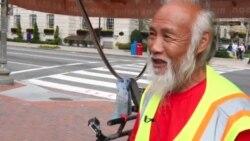 中国农民骑三轮车周游世界抵华盛顿