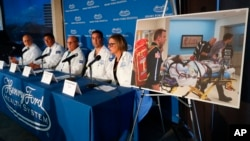 A photo of an unidentified patient whose lungs were irreparably damaged from vaping is displayed while medical staff at Henry Ford Hospital answer questions during a news conference in Detroit, Nov. 12, 2019.