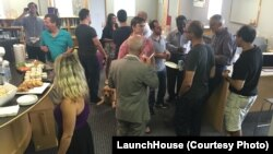 """Members gather at the LaunchHouse near Cleveland, Ohio for a """"brew and brainstorming"""" session. Entrepreneurs help each other come up with solutions and business ideas."""
