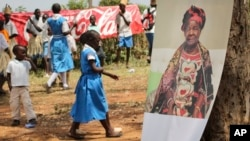 A poster of Sarah Obama, the step-grandmother of President Barack Obama, is displayed during a groundbreaking ceremony for her Mama Sarah Obama Foundation charitable organization, in her home town of Kogelo, near Kisumu, in Kenya Saturday, July 18, 2015.