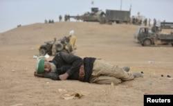 An elderly man with Shi'ite fighters sleeps in Tal Afar, Iraq, Nov. 16, 2016.