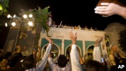 Former prime minister Nawaz Sharif, fourth from left, waves to supporters in Lahore, May 11, 2013.