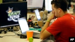FILE - An employee at DraftKings, a fantasy sports company, is seen working on his laptop at the company's offices in Boston, Massachusetts, Sept. 9, 2015.