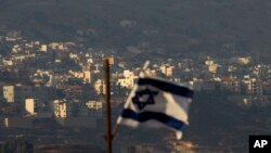 FILE - An Israeli flag flutters near the village of Majdal Shams in the Golan Heights.