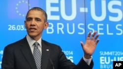 奥巴马总统3月26日在欧盟大楼对记者发表谈话
