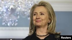 Secretaria de Estado, Hillary Clinton.