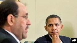 奥巴马(右)与马利基在白宫椭圆形办公室会谈